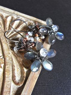 The Tempest earrings - labradorite, moonstone, iolite, sterling and copper combine to create a dramatic design.