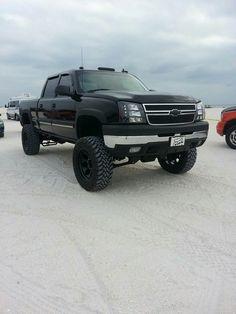 The Dmax got a 7 in BDS lift. 20 in Mickey Thompsons W 35 in open country MT ♥ 2004 Chevy Silverado, Chevy Duramax, Silverado Truck, Jeep Truck, Chevrolet Trucks, Lifted Chevy, Gm Trucks, Diesel Trucks, Lifted Trucks
