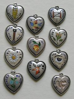 Selection of Rebus Antique Heart charms. Courtesy of Red Robin Antiques (Ruby Lane)