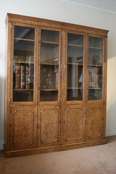 A Burr Oak Glazed Bookcase. Bevelled glass doors.