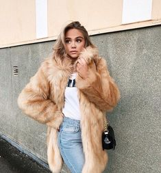 Fur coat + white tee + high waisted jeans.  Street style, street fashion, best street style, OOTD, OOTD Inspo, street style stalking, outfit ideas, what to wear now, Fashion Bloggers, Style, Seasonal Style, Outfit Inspiration, Trends, Looks, Outfits.