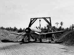 Mechanics boresighte the machine guns of Vought F4U, VMF-124, Guadalcanal, June 1943
