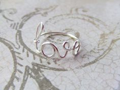 Love Ring Any Size Wire Word Ring Silver Wire Wrap Ring Mothers Gift Girlfriend Gift Friendship Ring New Mom Jewelry Gifts Under 10. $8.95, via Etsy.