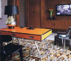 Campaign desk in Hermes orange; room by Jamie Herzlinger