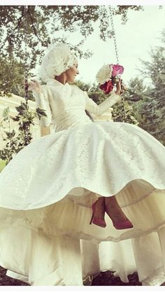 Lovely Dina, Mashallah! <3 I do love her wedding dress here.. maybe because shes having fun on a swing... hmmm