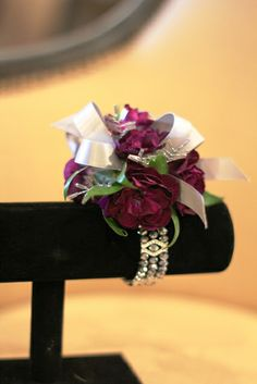 cute carnation corsage. purple and silver. bling. floral designs ltd.