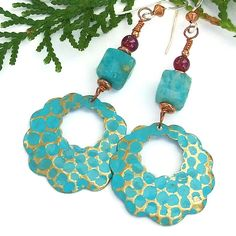 Beautifully long and dangly, the handmade CARIBBEAN CALM earrings will add flirty fun to any outfit you wear. The earrings were created with artisan hand painted and antiqued scalloped brass hoops in a gorgeous aqua turquoise color so reminiscent of calm Caribbean waters. by Catherine Waterhouse.   Charms by Metapolies™.