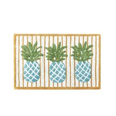 Add a fun touch to your bathroom decor with this HipStyle Hana Rug. This 100-percent cotton, tufted rug features three bright teal pineapples with an orange pinstripe design in the background.