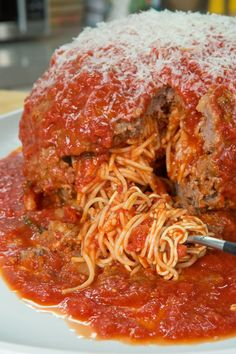This giant spaghetti-stuffed meatball is guaranteed to be a hit at the next party you throw.