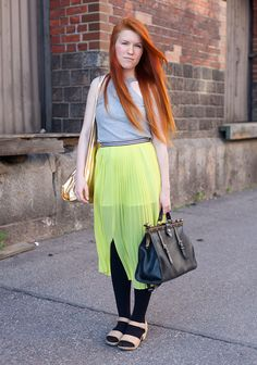 """""""I'm wearing a Topshop skirt from Helsinki10 and Marimekko shoes. My friend bought me the golden American Apparel bag from America. The other bag is vintage.Colours are everything, especially canary yellow."""""""