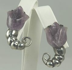 My sister now has the maching brooch to these earrings.  Aunty Lorna gave them as gifts from her time living in Texas.   Earrings | William Spratling.  Sterling silver and Amethysts.  ca. 1940 - 46.