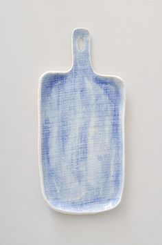 """Cheeseboardhandmade from textured porcelain clay and glazed in soft watercolor blue.  Approx. 11""""x 5""""  Handmade in North Carolina"""