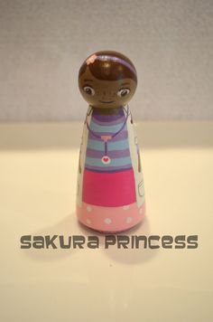 "Doc Mcstuffins Inspired Hand Painted Wood Peg Doll - cake topper - ornament - 3.5"" tall. $25.00, via Etsy."