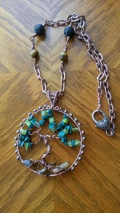 Wire wrapped tree of life necklace with Malachite chips and tiger's eye.