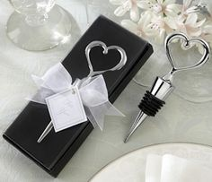 Heart-Shaped Chrome Bottle Stopper (Kate Aspen 11001NA) | Buy at Wedding Favors Unlimited (http://www.weddingfavorsunlimited.com/heart-shaped_chrome_bottle_stopper_with_personaliz.html).