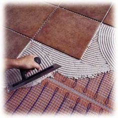 electric radiant floor heat - simply add an electric mat to boost a bath's existing heating system. It can take as long as 45 minutes to warm up, so put it on a programmable thermostat to chase away the chill by the time your alarm clock goes off. Toilet Decoration, Radiant Floor, Radiant Heat, Bathroom Shower Curtains, Bathroom Closet, Downstairs Bathroom, Heating Systems, Diy Home Improvement, Bath Remodel