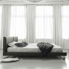 Cologne Bed at www.moderndigsfurniture.com, in slate, white or grey leather, this upholstered headboard and frame sit upon a chrome steel base