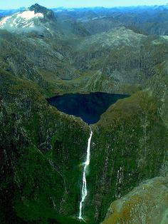 Sutherland Falls can only be accessed on foot via the popular Milford Track. This is a high volume waterfall which spills from Lake Quill carved into a glacial basin high on a mountainside in New Zealand's Fiordland National Park.