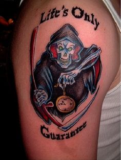 Grim Reaper tattoo in full and bold colors. Gone are the days were the Grim Reapers would always look dull and bleak, bright and red colors are also a trend now and helps instill more fearful expressions on the reaper.