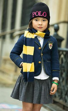 The back-to-school uniform style essentials for girls: with eye-catching striped trim and heritage-inspired embroidery, this fleece blazer combines a tailored look with the comfort of her favorite sweatshirt. The classic three-button design is wonderfully versatile and the cotton blend is undeniably cozy.