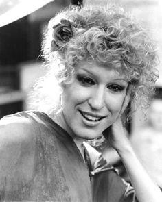 Bette Midler - wild curly hair pinned with a flower