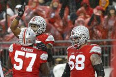 Nov 21, 2015; Columbus, OH, USA; Ohio State Buckeyes running back Ezekiel Elliott (15) celebrates with Buckeyes offensive lineman Chase Farris (57) and Buckeyes offensive lineman Taylor Decker (68) after scoring a touchdown against the Michigan State Spartans in the second quarter at Ohio Stadium. Mandatory Credit: Geoff Burke-USA TODAY Sports