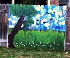 Painted Fence Ideas  If you are looking for some Painted Fence Ideas, here's one for ya!  Take your boring backyard fence and turn it into a painted masterpiece!  Both my girls and I had a blast creating this!