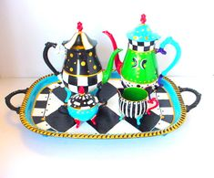 Silver Tea Set Alice in Wonderland Mad Hatter Tea by BuzyBeeBlooms, she uses enamel acrylic paint, fired in place, then sealed!