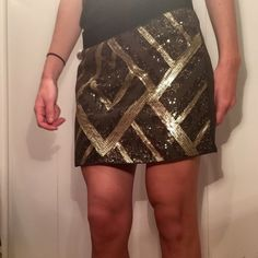 Geometric Sequins Skirt A fun and flirty skirt, bound to catch someone's eye. With its sequin embellished front and polyester back accented with a gold zipper, it is a great going out/night look. *no trades *worn once *perfect condition Authentic Icon Skirts