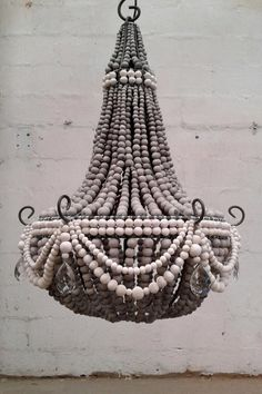 TEARDROP med chandelier in hand rolled clay/ ceramic beads. We choose not to work with cheap imported wooden beads as we support a community of HIV affected women. By choosing to use these beads we support over 157 families every month. This obviously mas (Diy Wood Work Entryway)
