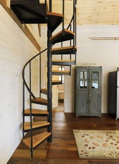 Vermont wood cabin -- rustically delicious. A spiral staircase is one of the main architectural finds from a salvage shop in Vermont.