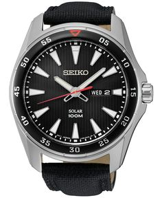 Luminous hands highlight the black dial of this Seiko Sport watch, while the dignified black leather strap wraps securely around your wrist. | Black leather strap | Round stainless steel case, 43mm |