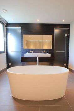 We love the oval ios bath paired with the sharp, clean lines of the basin, shower and mirror.