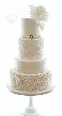 Wedding Cakes - Whimsical & Floral The Whimsical Cakery - Elegant bespoke wedding cakes and dessert tables. Wedding Cakes Northamptonshire. Ruffles ivory, sparkles