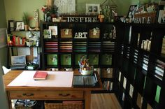 Very organized, clean idea for studio bookshelves - BUT, could I keep it looking like this? Not.