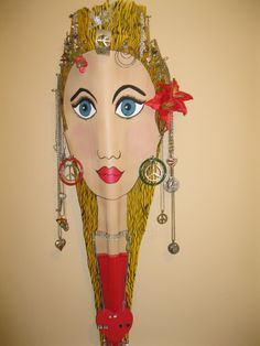 This is Lauren she is a Palm frond that I painted and designed to display jewelry.