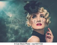 Elegant blond retro woman wearing little hat with veil in smoke Stock Photo - stock image, images, royalty free photo, stock photos, stock photograph, stock photographs, picture, pictures, graphic, graphics