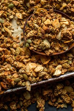NYT Cooking: homemade granola, filled with crisp, sweet clumps of oats, coconut flakes and seeds. You can also cut the brown sugar in half. The granola will be less sweet and less cluster-packed but still quite satisfying.