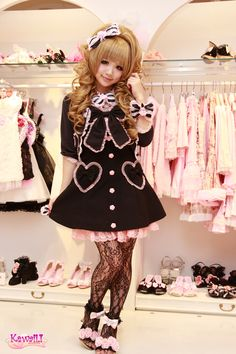 """Cute as a doll! """"Miki, a shop staff works here for 1 year wears black & pink…"""