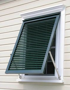 """This Bahama Shutter is built to finished dimensions of 34"""" x 33"""". The shutter will fit a window 28"""" wide and 27"""" high. A tropical island favorite for over 50 y"""