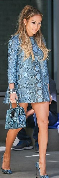 Jennifer Lopez's blue snake print dress, python handbag, pumps, and studded jewelry.