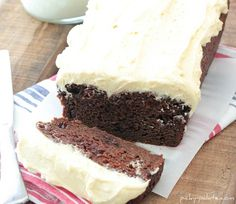 Double Chocolate Pumpkin Cake with pumpkin spice buttercream frosting...made with loads of sour cream, pumpkin pie filling, and chocolate chips!