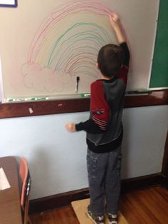 Crossing midline to draw a rainbow while standing on a balance board. Gross Motor Activities, Class Activities, Gross Motor Skills, Sensory Activities, Pediatric Occupational Therapy, Pediatric Ot, Learning Time, Learning Styles, Physical Education Games