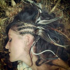 Warrior hair and feathers and plaits