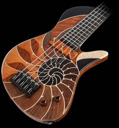 Introducing the Masterbuilt - Nautilus! Inspired by the beautiful and intricate Nautilus shell, Masterbuilt – Nautilus utilizes our… Guitar Art, Cool Guitar, Hammered Dulcimer, Nautilus Shell, Bass Guitars, Guitar Design, Ukulele, Musical Instruments, Acoustic