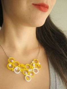 ~ Modern paper necklace. Handmade out of precisely cut quilling strips in yellow and white. Minimalistic, stylish and original jewerly.  Matching earrings for this necklace: https://www.etsy.com/listing/171108410  ~ The necklace is polished with non toxic acrylic varnish for water resistance. The coating protects and hardens the paper and makes the structure of the paper piece strong.  ~ How to care for the paper jewelry: Dont wear them when you sleep and take a bath to protect them from…