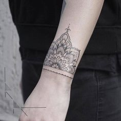 Half mandala on the wrist by Rachainsworth. Tattoo artist:... geometric shape;band;black;of sacred geometry shapes;mandala;rachainsworth;wristband;blackwork;wrist;tatuaje;sacred geometry;tatuajes;medium size;geometric;half mandala