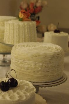 small multiple wedding cakes with different flavors  I like this idea of a different flavor/texture and several smaller cakes. ~ KSM