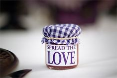 A cute wedding favour idea that is super easy to re-create at home. Collect minature jars in advance and fill them with home-made jams or chutneys for your guests to take home as a wedding favour.