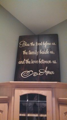 Bless this food...placed above kitchen cabinets in a corner.